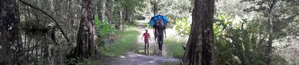 puddle kid umbrella two adults copy